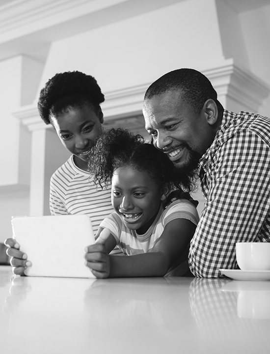 African American Family looking at tablet