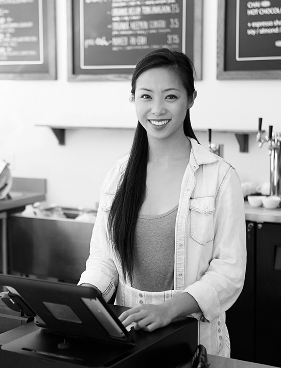 Small business Asian girl at the register of her coffee shop