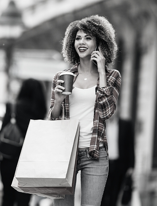 Women Shopping with coffee on her phone